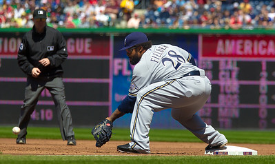 Prince Fielder scoops up a low throw