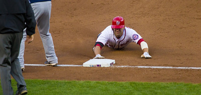 Danny Espinosa slides into third with a bases loaded triple in the second game of a sweep. Rookie second baseman Espinosa led all hitters collecting six RBIs, and driving in the go ahead runs in in each game.