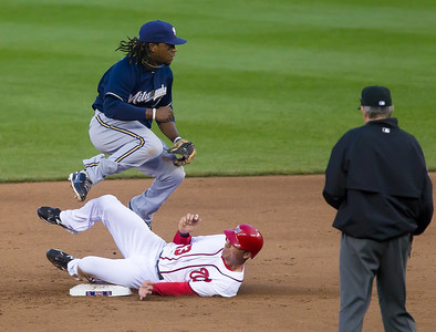 Nationals Rick Ankiel tries to break up a double play throw by Brewers Rickie Weeks