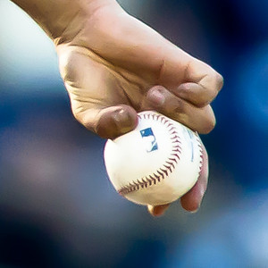extreme close-up of Pitcher Marco Estrada's grip