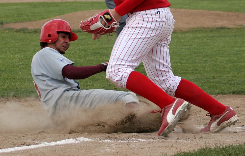 Ivan Munoz - Stealing third base.