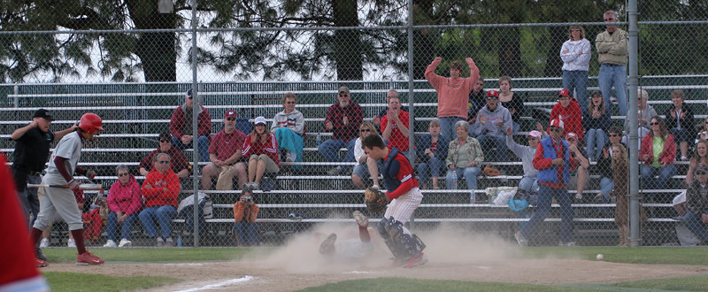 Rob Fila - Left Field / Relief Pitcher.  Head first slide in the dirt... successful steal of home.