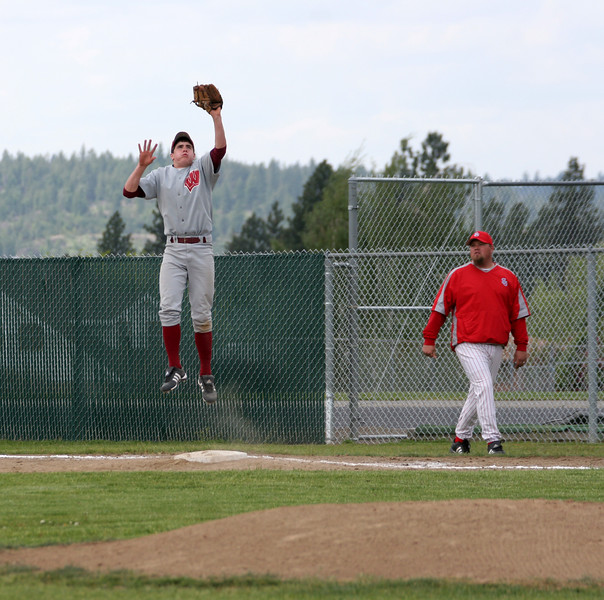 Kenny Davis - 1st Base.  Reaching up for a high throw from third.