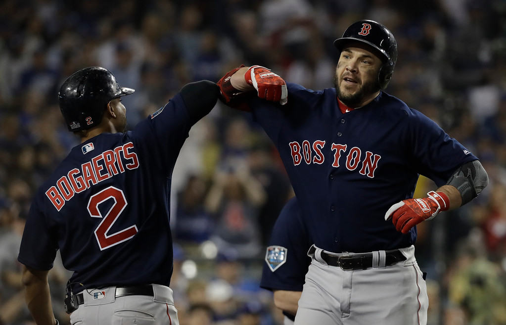 . Boston Red Sox\'s Steve Pearce celebrates his second home run with Xander Bogaerts during the eighth inning in Game 5 of the World Series baseball game against the Los Angeles Dodgers on Sunday, Oct. 28, 2018, in Los Angeles. (AP Photo/David J. Phillip)