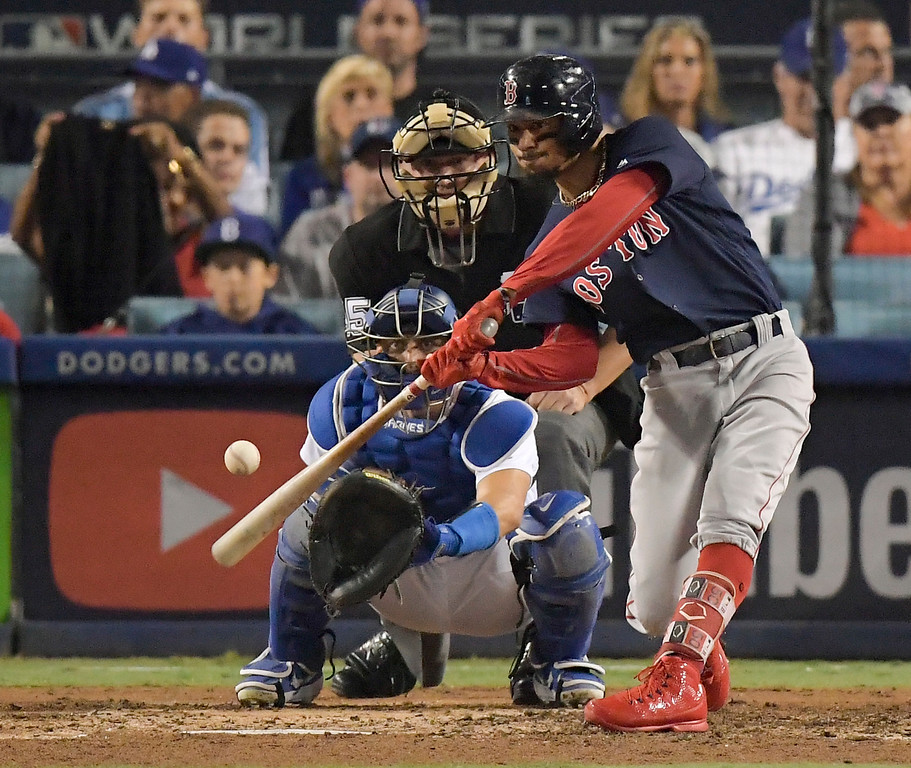 . Boston Red Sox\'s Mookie Betts hits a home run off Los Angeles Dodgers starting pitcher Clayton Kershaw during the sixth inning in Game 5 of the World Series baseball game on Sunday, Oct. 28, 2018, in Los Angeles. (AP Photo/Mark J. Terrill)