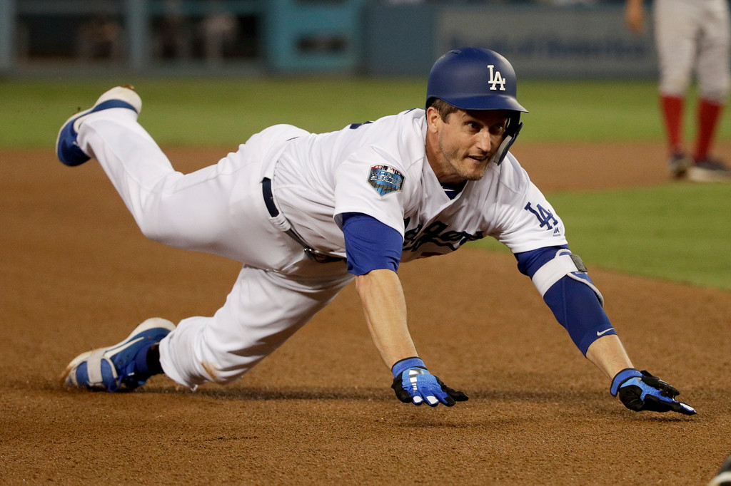 . Los Angeles Dodgers\' David Freese dives safely into third base for the triple against the Boston Red Sox during the third inning in Game 5 of the World Series baseball game on Sunday, Oct. 28, 2018, in Los Angeles. (AP Photo/Jae C. Hong)