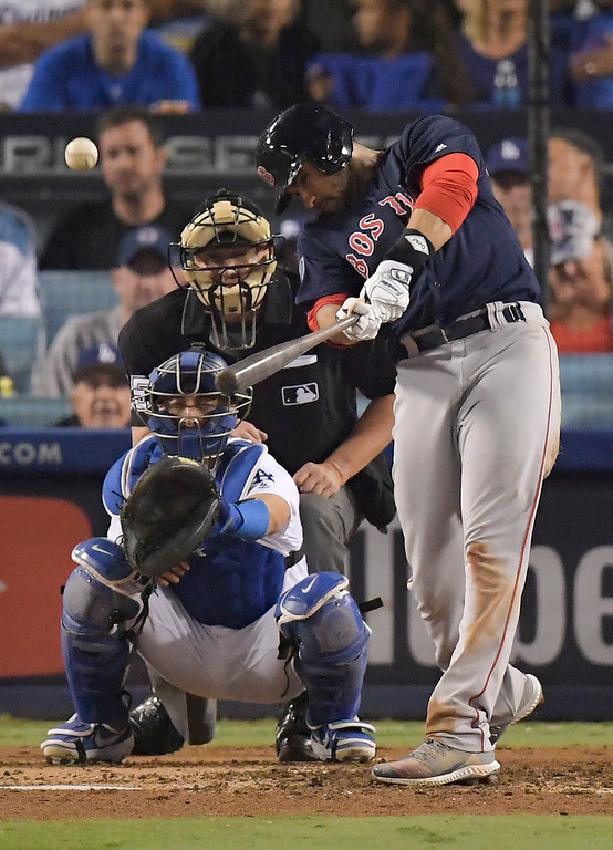 . Boston Red Sox\'s J.D. Martinez hits a home run against the Los Angeles Dodgers during the seventh inning in Game 5 of the World Series baseball game on Sunday, Oct. 28, 2018, in Los Angeles. (AP Photo/Mark J. Terrill)
