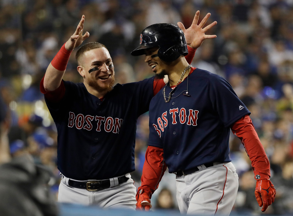 . Boston Red Sox\'s Mookie Betts celebrates with Christian Vazquez after hitting a solo home run against Los Angeles Dodgers\' Clayton Kershaw during the sixth inning in Game 5 of the World Series baseball game on Sunday, Oct. 28, 2018, in Los Angeles. (AP Photo/David J. Phillip)