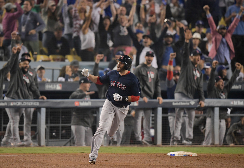 . Boston Red Sox\'s J.D. Martinez celebrates his home run against the Los Angeles Dodgers during the seventh inning in Game 5 of the World Series baseball game on Sunday, Oct. 28, 2018, in Los Angeles.(AP Photo/Mark J. Terrill)