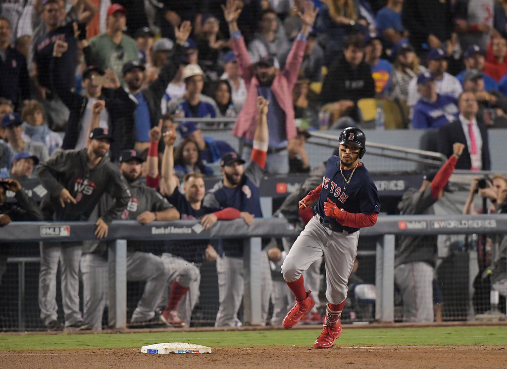 . Boston Red Sox\'s Mookie Betts rounds the bases after a home run during the sixth inning in Game 5 of the World Series baseball game against the Los Angeles Dodgers on Sunday, Oct. 28, 2018, in Los Angeles. (AP Photo/Mark J. Terrill)