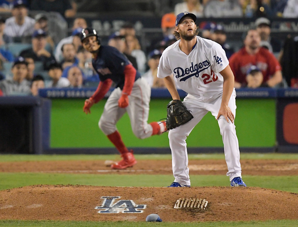 . Boston Red Sox\'s Mookie Betts, left, watches his home run off Los Angeles Dodgers starting pitcher Clayton Kershaw during the sixth inning in Game 5 of the World Series baseball game on Sunday, Oct. 28, 2018, in Los Angeles. (AP Photo/Mark J. Terrill)