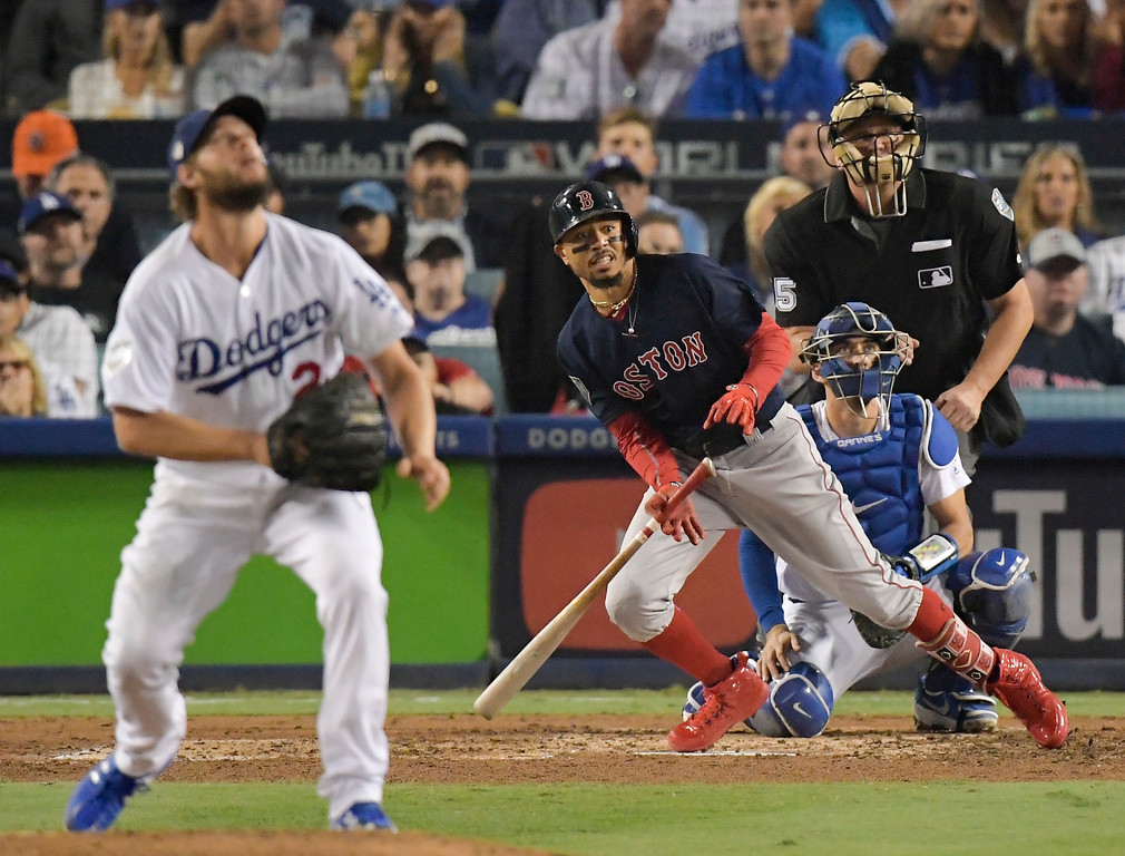 . Boston Red Sox\'s Mookie Betts, right, watches his home run off Los Angeles Dodgers starting pitcher Clayton Kershaw during the sixth inning in Game 5 of the World Series baseball game on Sunday, Oct. 28, 2018, in Los Angeles. (AP Photo/Mark J. Terrill)