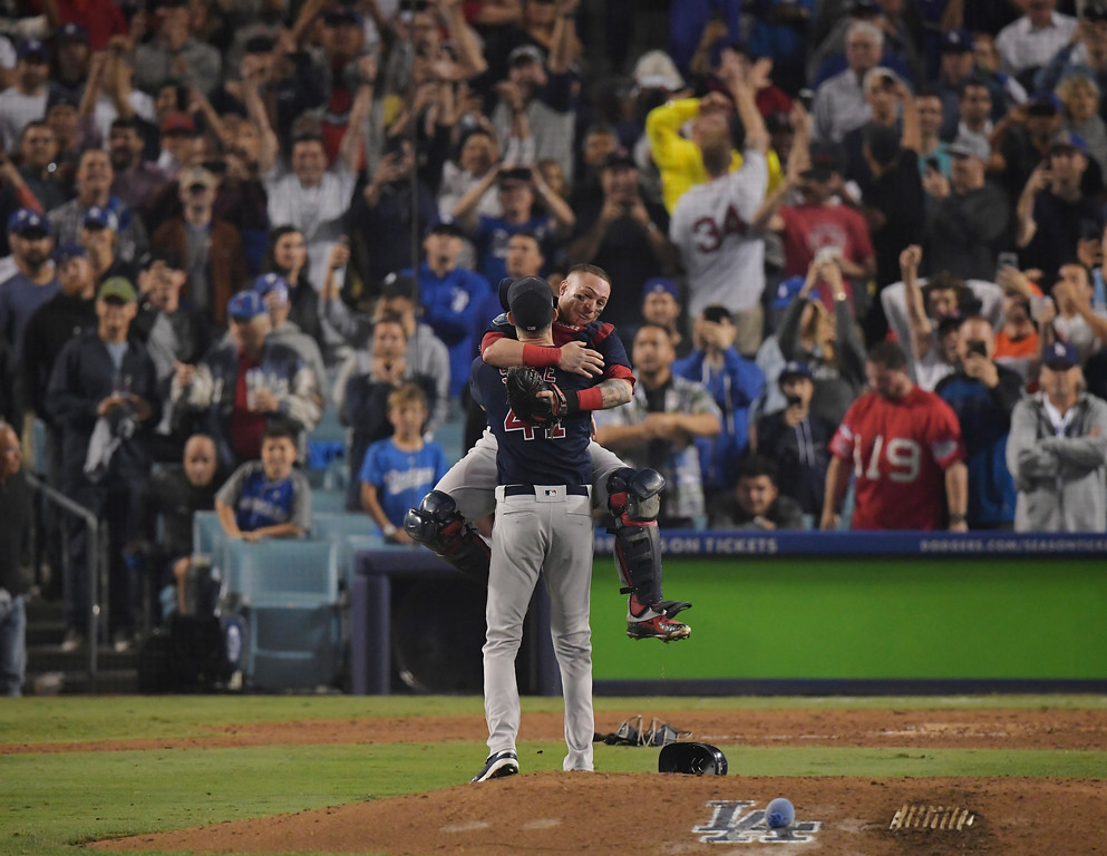 . Boston Red Sox catcher Christian Vazquez jumps into Chris Sale\'s arms after Game 5 of baseball\'s World Series against the Los Angeles Dodgers on Sunday, Oct. 28, 2018, in Los Angeles. The Red Sox won 5-1 to win the series 4 game to 1. (AP Photo/Mark J. Terrill)
