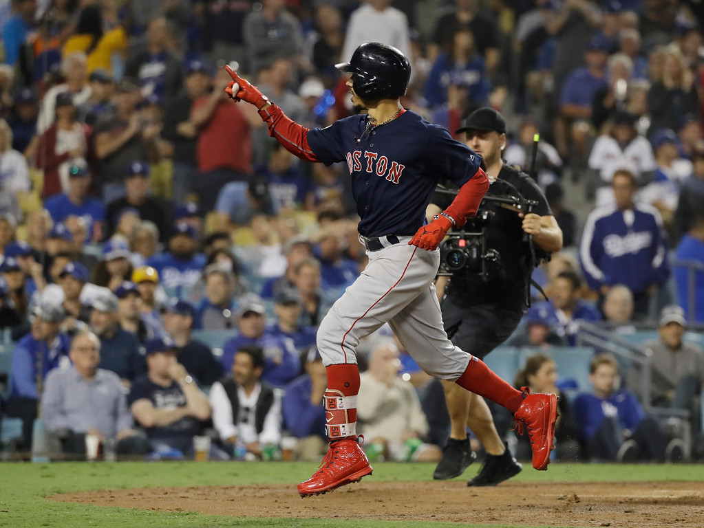 . Boston Red Sox\'s Mookie Betts celebrates after hitting a solo home run against Los Angeles Dodgers\' Clayton Kershaw during the sixth inning in Game 5 of the World Series baseball game on Sunday, Oct. 28, 2018, in Los Angeles. (AP Photo/David J. Phillip)