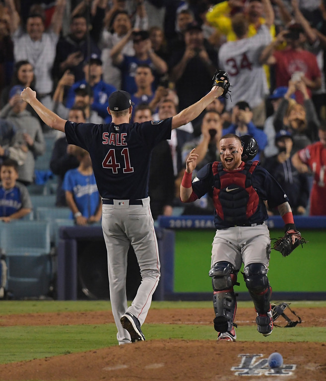 . Boston Red Sox catcher Christian Vazquez celebrates Chris Sale\'s arms after Game 5 of baseball\'s World Series against the Los Angeles Dodgers on Sunday, Oct. 28, 2018, in Los Angeles. The Red Sox won 5-1 to win the series 4 game to 1. (AP Photo/Mark J. Terrill)