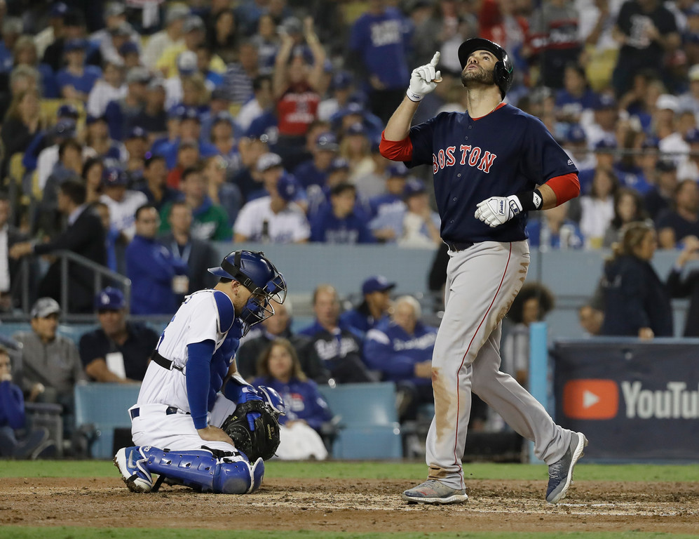 . Los Angeles Dodgers catcher Austin Barnes waits at the plate as Boston Red Sox\'s J.D. Martinez scores after hitting a solo home run against Los Angeles Dodgers\' Clayton Kershaw during the seventh inning in Game 5 of the World Series baseball game on Sunday, Oct. 28, 2018, in Los Angeles. (AP Photo/David J. Phillip)