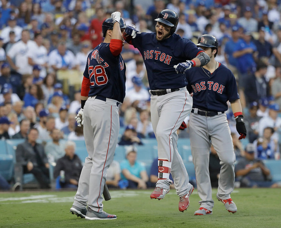 . Boston Red Sox\'s Steve Pearce celebrates with J.D. Martinez (28) and Andrew Benintendi after hitting a two-run home run during the first inning in Game 5 of the World Series baseball game on Sunday, Oct. 28, 2018, in Los Angeles. (AP Photo/David J. Phillip)