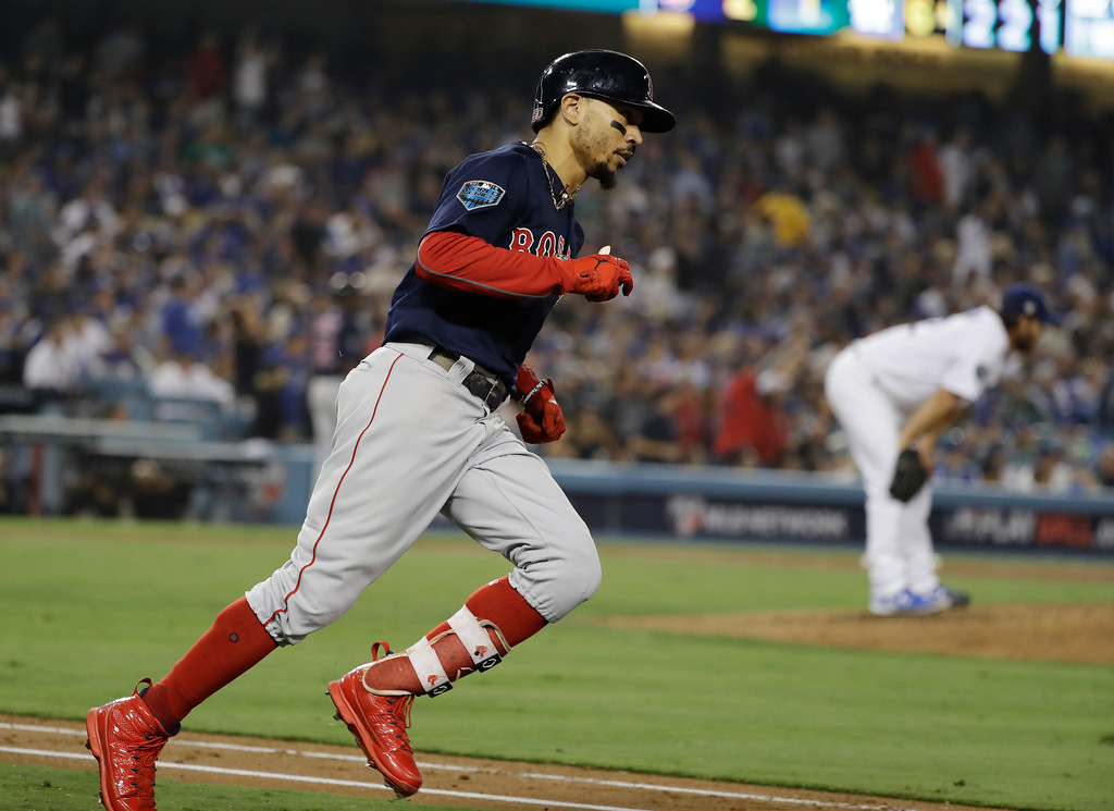 . Boston Red Sox\'s Mookie Betts runs the bases after hitting a solo home run against Los Angeles Dodgers\' Clayton Kershaw, right, during the sixth inning in Game 5 of the World Series baseball game on Sunday, Oct. 28, 2018, in Los Angeles. (AP Photo/David J. Phillip)