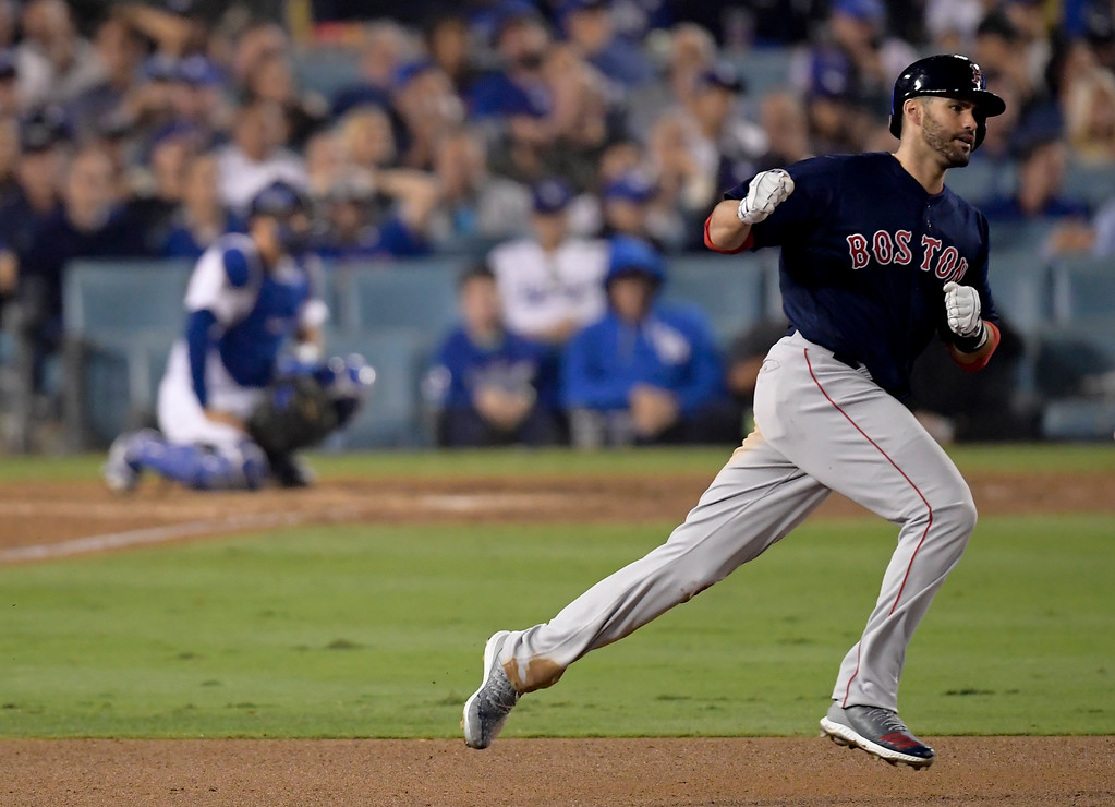 . Boston Red Sox\'s J.D. Martinez celebrates his home run against the Los Angeles Dodgers during the seventh inning in Game 5 of the World Series baseball game on Sunday, Oct. 28, 2018, in Los Angeles. (AP Photo/Mark J. Terrill)