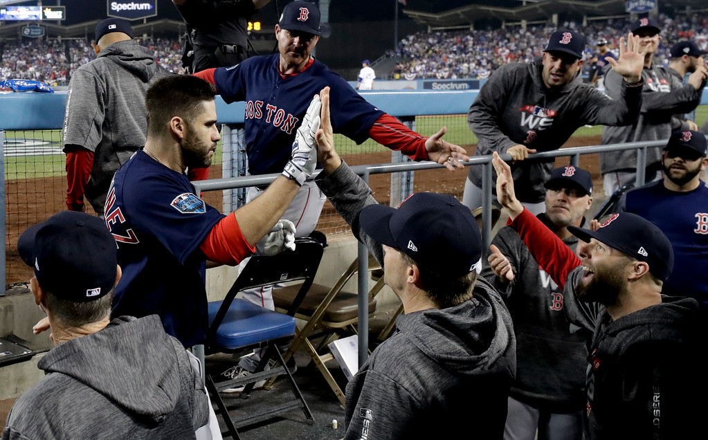 . Boston Red Sox\'s J.D. Martinez celebrates in the dugout after his home run against the Los Angeles Dodgers during the seventh inning in Game 5 of the World Series baseball game on Sunday, Oct. 28, 2018, in Los Angeles. (AP Photo/David J. Phillip)