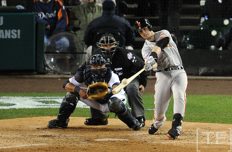 Oct 28, 2012; Detroit, MI, USA; San Francisco Giants catcher Buster Posey hits a two-run home run against the Detroit Tigers in the sixth inning during game four of the 2012 World Series at Comerica Park.  Mandatory Credit: Tim Fuller-USA TODAY Sports