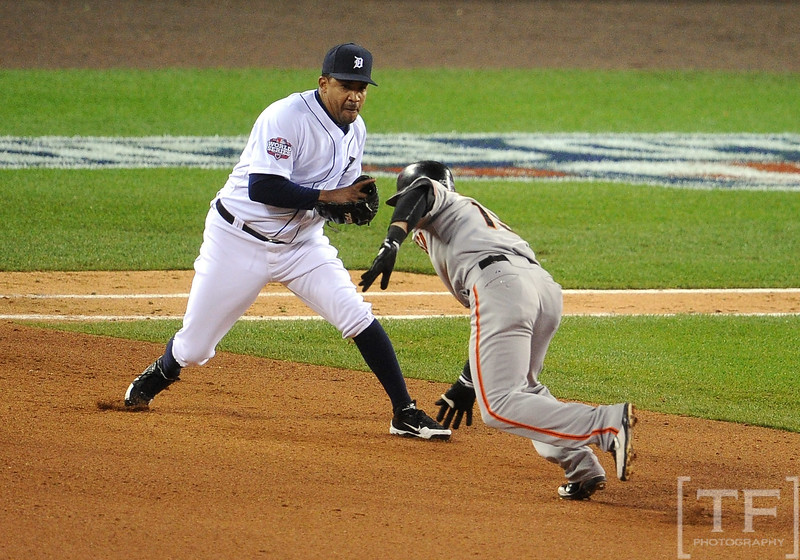 Oct 28, 2012; Detroit, MI, USA; San Francisco Giants second baseman Marco Scutaro (right) is tagged out by Detroit Tigers pitcher Octavio Dotel in the 8th inning during game four of the 2012 World Series at Comerica Park.  Mandatory Credit: Tim Fuller-USA TODAY Sports