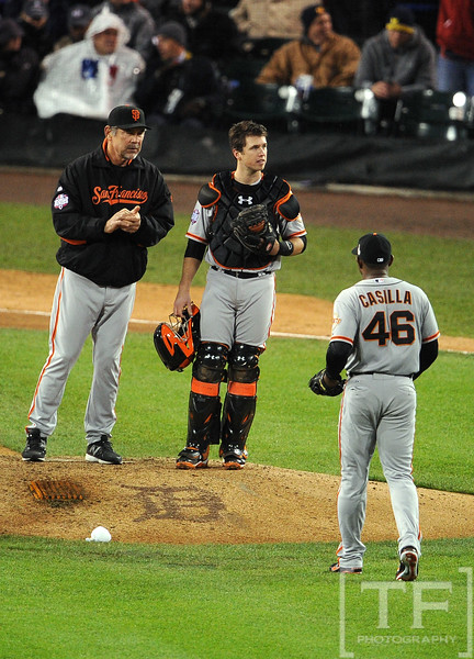 Oct 28, 2012; Detroit, MI, USA; San Francisco Giants manager Bruce Bochy (left) and catcher Buster Posey (middle) wait for pitcher Santiago Casilla (46) during a pitching change against the Detroit Tigers in the 9th inning during game four of the 2012 World Series at Comerica Park.  Mandatory Credit: Tim Fuller-USA TODAY Sports