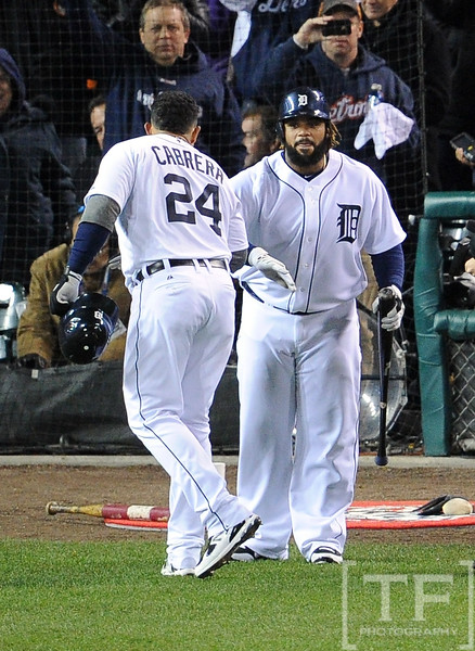 Oct 28, 2012; Detroit, MI, USA; Detroit Tigers third baseman Miguel Cabrera (24) is congratulated by teammate Prince Fielder after hitting a two-run home run against the San Francisco Giants in the third inning during game four of the 2012 World Series at Comerica Park.  Mandatory Credit: Tim Fuller-USA TODAY Sports
