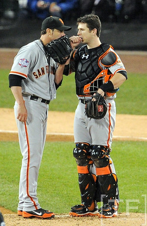 Oct 27, 2012; Detroit, MI, USA; San Francisco Giants pitcher Ryan Vogelsong (left) talks with catcher Buster Posey (right) in the fifth inning during game three of the 2012 World Series against the Detroit Tigers at Comerica Park.  Mandatory Credit: Tim Fuller-USA TODAY Sports