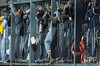 Oct 27, 2012; Detroit, MI, USA; Fans reach their arms through a fence as they watch game three of the 2012 World Series between the Detroit Tigers and the San Francisco Giants at Comerica Park.  Mandatory Credit: Tim Fuller-USA TODAY Sports