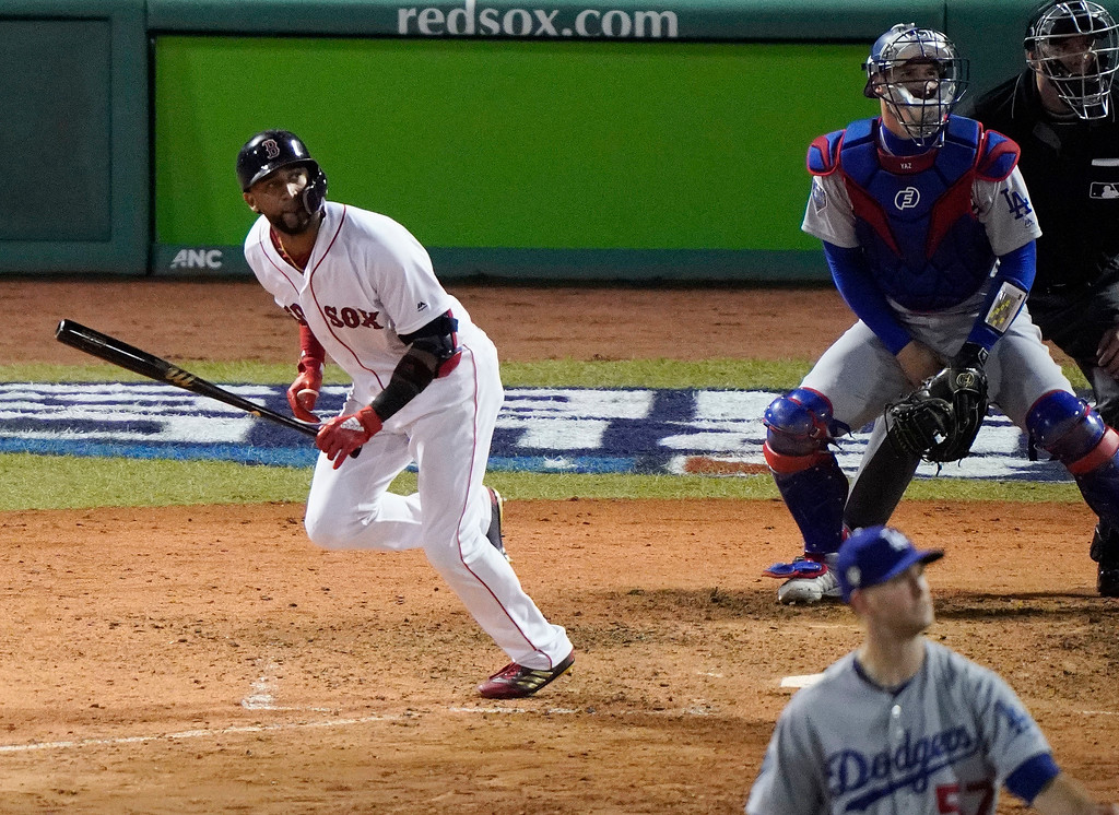. Boston Red Sox\'s Eduardo Nunez watches his three-run home run off Los Angeles Dodgers relief pitcher Alex Wood, front, during the seventh inning of Game 1 of the World Series baseball game Tuesday, Oct. 23, 2018, in Boston. (AP Photo/Elise Amendola)