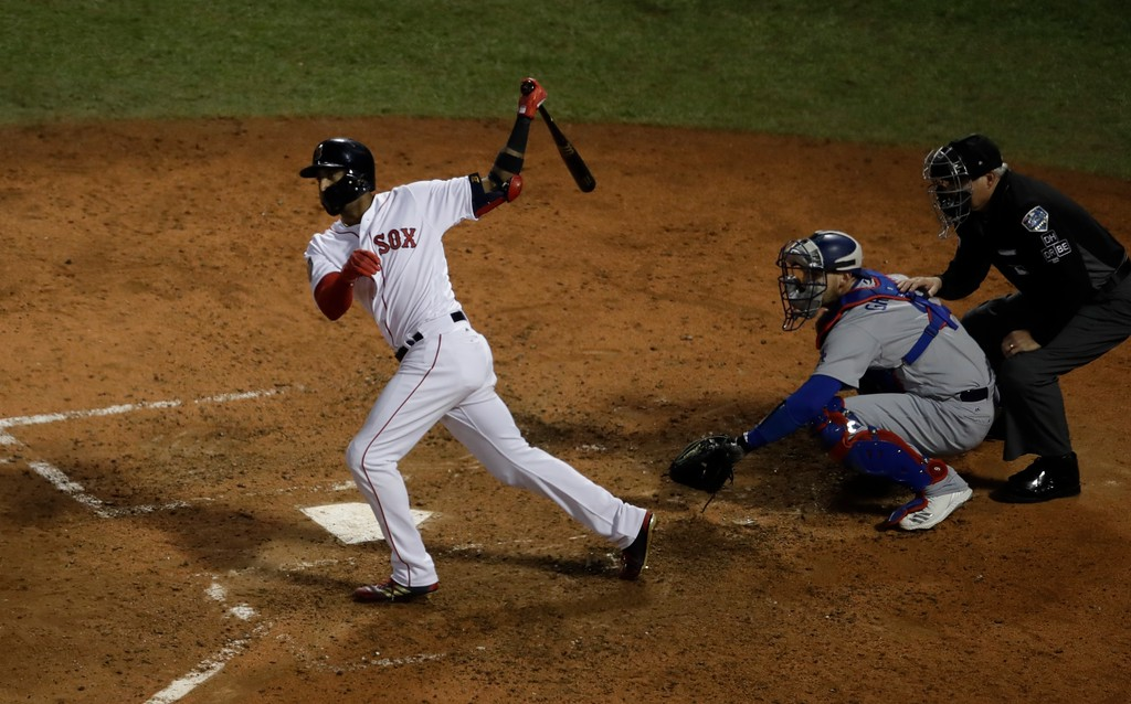 . Boston Red Sox\'s Eduardo Nunez hits a three-run home run during the seventh inning of Game 1 of the World Series baseball game against the Los Angeles Dodgers Tuesday, Oct. 23, 2018, in Boston. (AP Photo/Charles Krupa)
