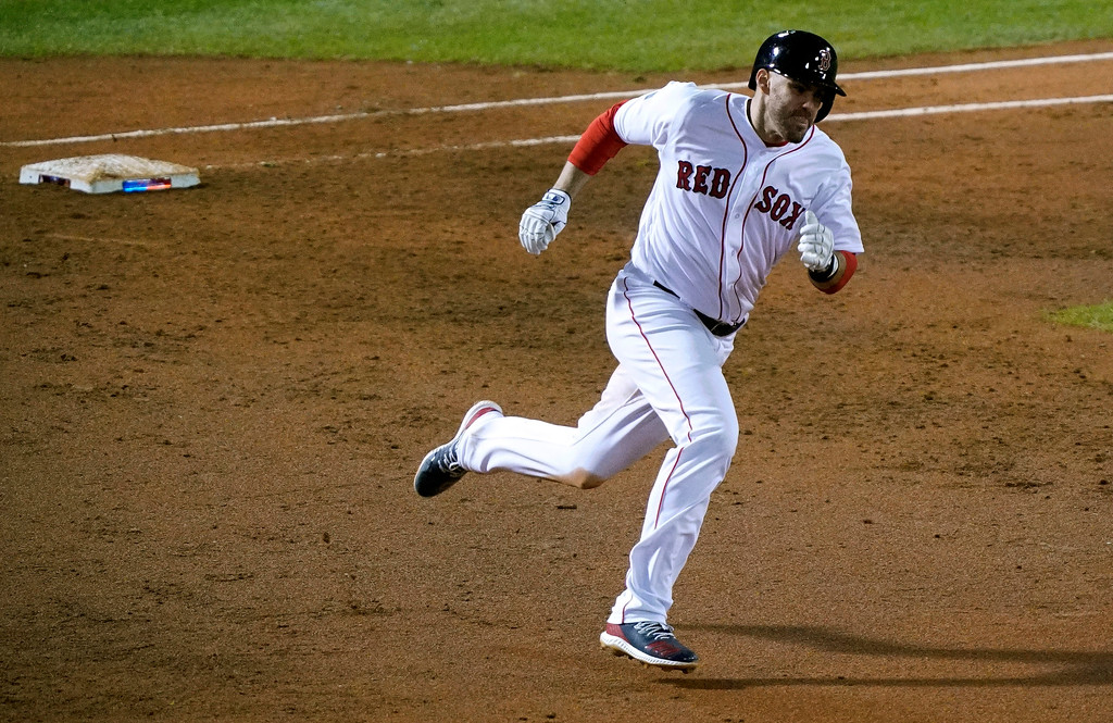 . Boston Red Sox\'s J.D. Martinez rounds first after hitting an RBI double against the Los Angeles Dodgers during the third inning of Game 1 of the World Series baseball game Tuesday, Oct. 23, 2018, in Boston. (AP Photo/Elise Amendola)