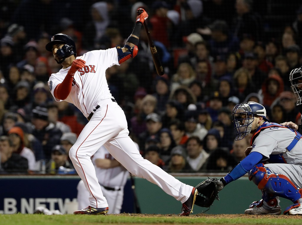 . Boston Red Sox\'s Eduardo Nunez hits a three-run home run during the seventh inning of Game 1 of the World Series baseball game against the Los Angeles Dodgers Tuesday, Oct. 23, 2018, in Boston. (AP Photo/Matt Slocum)