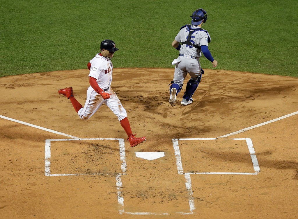. Boston Red Sox\'s Mookie Betts scores past Los Angeles Dodgers catcher Austin Barnes during the first inning of Game 1 of the World Series baseball game Tuesday, Oct. 23, 2018, in Boston. (AP Photo/David J. Phillip)