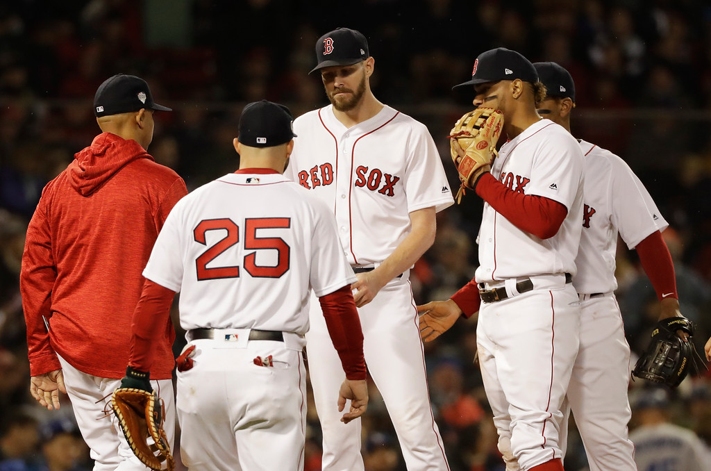 . Boston Red Sox\'s starting pitcher Chris Sale, center, is relieved in the fifth inning of Game 1 of the World Series baseball game against the Los Angeles Dodgers Tuesday, Oct. 23, 2018, in Boston. (AP Photo/David J. Phillip)