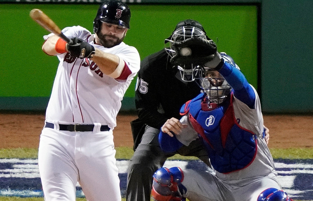 . Boston Red Sox\'s Mitch Moreland strikes out during the seventh inning of Game 1 of the World Series baseball game against the Los Angeles Dodgers Tuesday, Oct. 23, 2018, in Boston. (AP Photo/Elise Amendola)