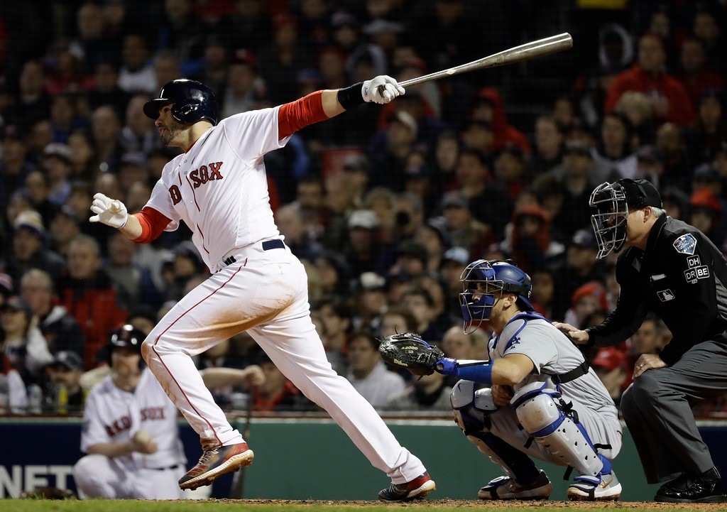 . Boston Red Sox\'s J.D. Martinez hits an RBI double during the third inning of Game 1 of the World Series baseball game against the Los Angeles Dodgers Tuesday, Oct. 23, 2018, in Boston. (AP Photo/Matt Slocum)