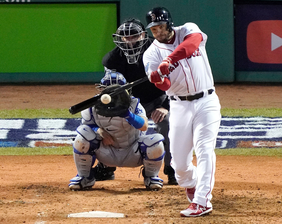 . Boston Red Sox\'s J.D. Martinez hits an RBI double against the Los Angeles Dodgers during the third inning of Game 1 of the World Series baseball game Tuesday, Oct. 23, 2018, in Boston. (AP Photo/Elise Amendola)