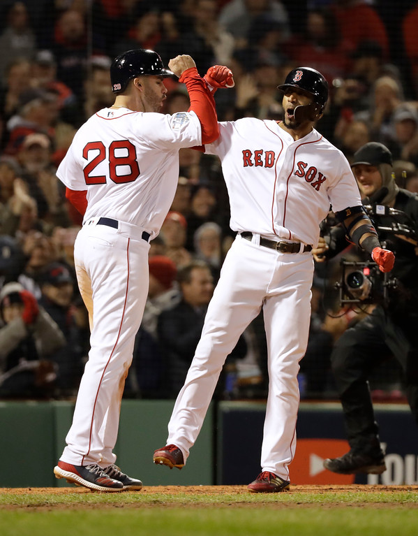 . Boston Red Sox\'s Eduardo Nunez celebrates with J.D. Martinez, left, after hitting a three-run home run during the seventh inning of Game 1 of the World Series baseball game against the Los Angeles Dodgers Tuesday, Oct. 23, 2018, in Boston. (AP Photo/David J. Phillip)