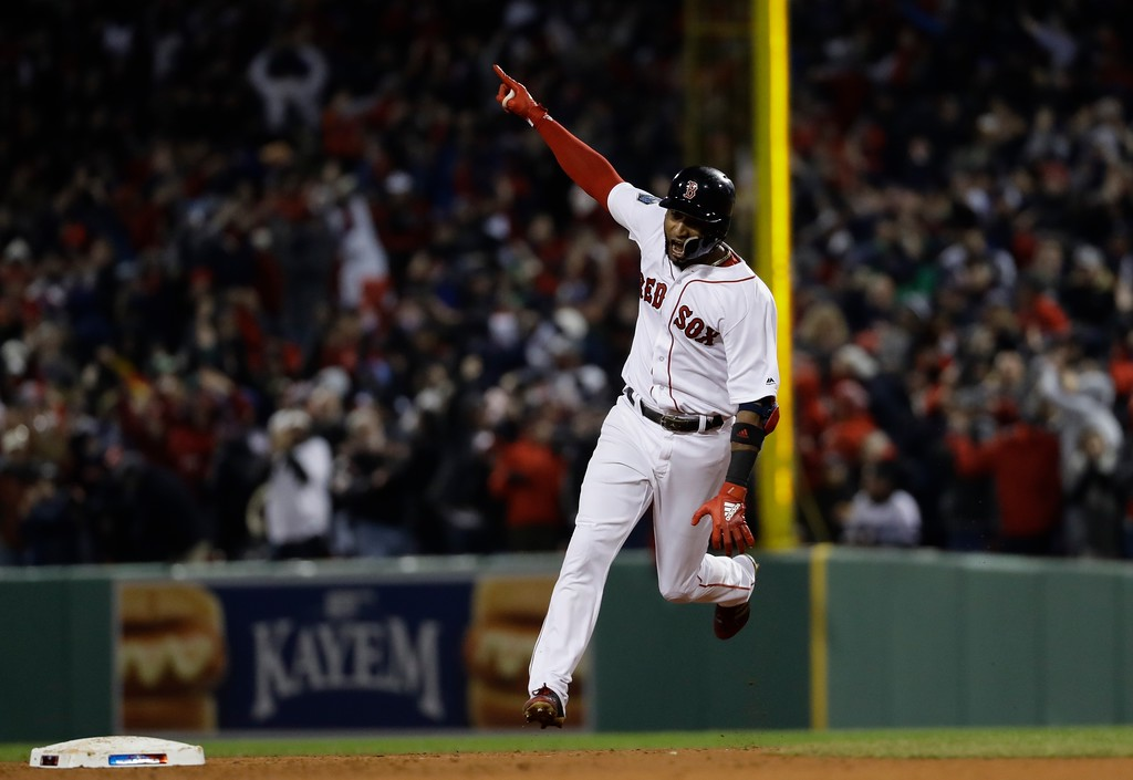 . Boston Red Sox\'s Eduardo Nunez reacts after hitting a three-run home run during the seventh inning of Game 1 of the World Series baseball game against the Los Angeles Dodgers Tuesday, Oct. 23, 2018, in Boston. (AP Photo/Matt Slocum)