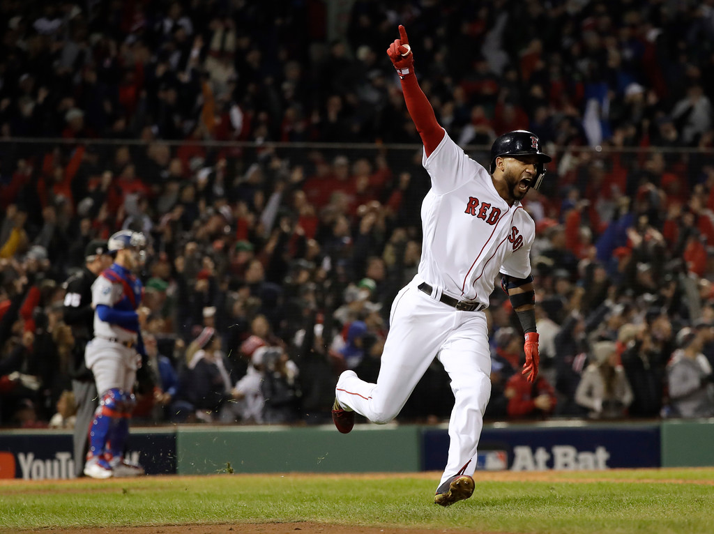. Boston Red Sox\'s Eduardo Nunez reacts after hitting a three-run home run during the seventh inning of Game 1 of the World Series baseball game against the Los Angeles Dodgers Tuesday, Oct. 23, 2018, in Boston. (AP Photo/David J. Phillip)