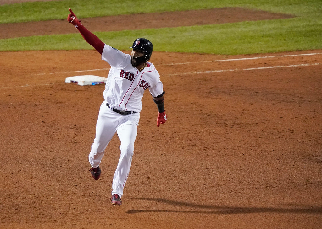 . Boston Red Sox\'s Eduardo Nunez rounds the bases after hitting a three-run home run against the Los Angeles Dodgers during the seventh inning of Game 1 of the World Series baseball game Tuesday, Oct. 23, 2018, in Boston. (AP Photo/Elise Amendola)