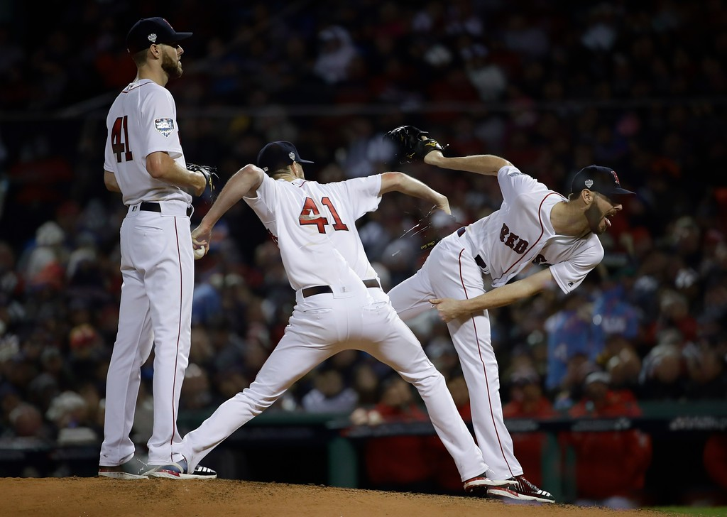 . This multiple exposure shows Boston Red Sox starting pitcher Chris Sale throwing during the fourth inning of Game 1 of the World Series baseball game against the Los Angeles Dodgers Tuesday, Oct. 23, 2018, in Boston. (AP Photo/Matt Slocum)