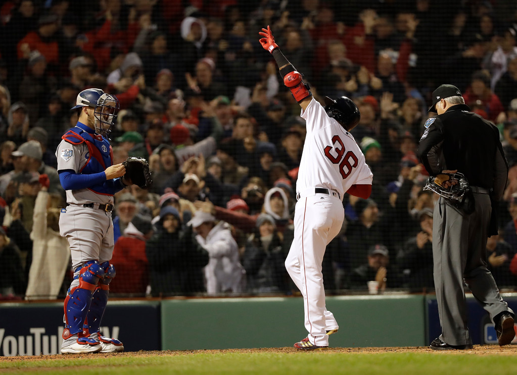 . Los Angeles Dodgers catcher Austin Barnes watches as Boston Red Sox\'s Eduardo Nunez reacts after hitting a three-run home run during the seventh inning of Game 1 of the World Series baseball game against the Los Angeles Dodgers Tuesday, Oct. 23, 2018, in Boston. (AP Photo/David J. Phillip)
