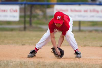 Isaiah warming up at 2nd base. The Nationals started out their season with a 4-1 win over the Pirates. 2012 Arlington Little League Baseball, Majors Division. Nationals vs Pirates (14 Apr 2012) (Image taken by Patrick R. Kane on 14 Apr 2012 with Canon EOS-1D Mark III at ISO 200, f2.8, 1/1600 sec and 200mm)