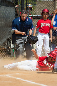 Alex tagged out trying to steal home on a passed ball in the bottom of the 2nd inning. The Nationals played a close and exciting game against the Cubs before being outscored in the 6th inning, losing 8-9. They are now 2-1 for the season. 2012 Arlington Little League Baseball, Majors Division. Nationals vs Cubs (21 Apr 2012) (Image taken by Patrick R. Kane on 21 Apr 2012 with Canon EOS-1D Mark III at ISO 200, f2.8, 1/4000 sec and 300mm)