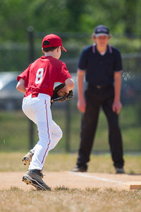 Toby fielding a hit near 1st base for the out in the top of the 3rd inning. The Nationals played a close and exciting game against the Cubs before being outscored in the 6th inning, losing 8-9. They are now 2-1 for the season. 2012 Arlington Little League Baseball, Majors Division. Nationals vs Cubs (21 Apr 2012) (Image taken by Patrick R. Kane on 21 Apr 2012 with Canon EOS-1D Mark III at ISO 200, f2.8, 1/2000 sec and 300mm)