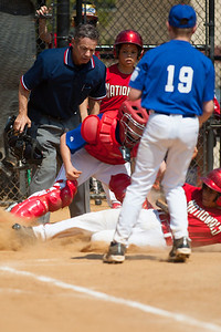 Alex tagged out trying to steal home on a passed ball in the bottom of the 2nd inning. The Nationals played a close and exciting game against the Cubs before being outscored in the 6th inning, losing 8-9. They are now 2-1 for the season. 2012 Arlington Little League Baseball, Majors Division. Nationals vs Cubs (21 Apr 2012) (Image taken by Patrick R. Kane on 21 Apr 2012 with Canon EOS-1D Mark III at ISO 200, f2.8, 1/5000 sec and 300mm)