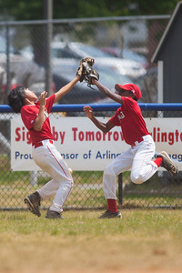 The gloves of Alex and Alex collide, missing the deep hit to center field in the top of the 6th inning. The Nationals played a close and exciting game against the Cubs before being outscored in the 6th inning, losing 8-9. They are now 2-1 for the season. 2012 Arlington Little League Baseball, Majors Division. Nationals vs Cubs (21 Apr 2012) (Image taken by Patrick R. Kane on 21 Apr 2012 with Canon EOS-1D Mark III at ISO 200, f2.8, 1/3200 sec and 300mm)